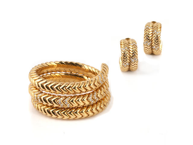 A diamond coil bracelet with matching clip-earrings, Bulgari