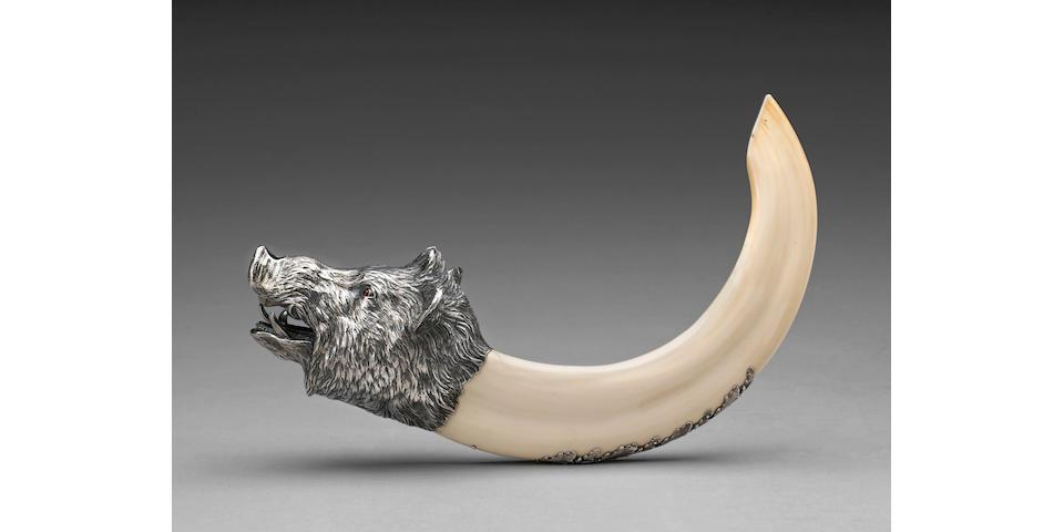 An Austrian silver and ivory boar's head cigar cutter