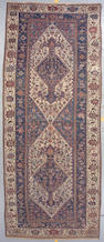 A Bakthiari long carpet Southwest Persia, size approximately 6ft. 10in. x 16ft. 10in.