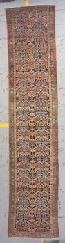 A Northwest Persian runner size approximately 3ft. 6in. x 16ft. 8in.