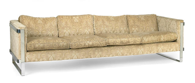 A modern chrome framed upholstered sofa