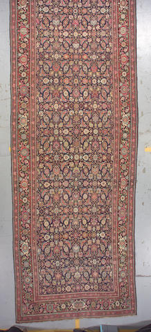A Karabagh long carpet size approximately 6ft. 6in. x 19ft. 3in.
