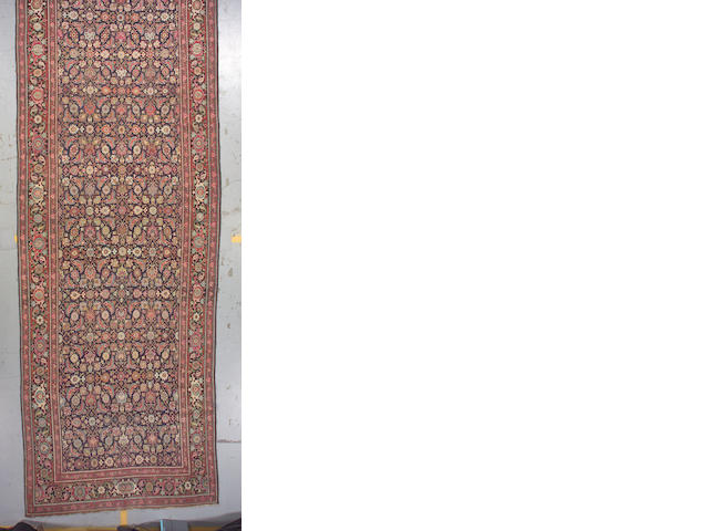 A Karabagh long carpet South Caucasian, size approximately 6ft. 6in. x 19ft. 3in.
