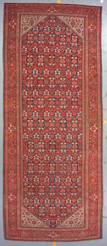 A Malayer long carpet Central Persia, size approximately 6ft. 11in. x 16ft. 4in.