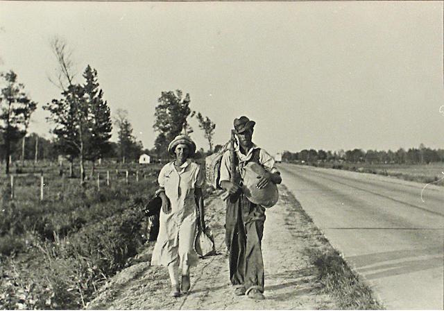 Carl Mydans A Man and Woman walking along the highway, 1936 Gelatin silver print