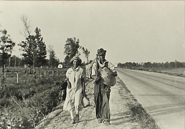 Carl Mydans A Man and Woman walking along the highway, 1936 Gelatin silver print