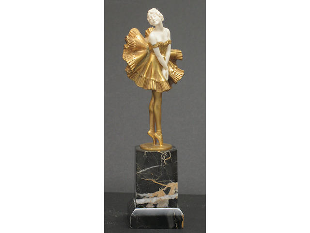 A German gilt bronze and ivory ballerina