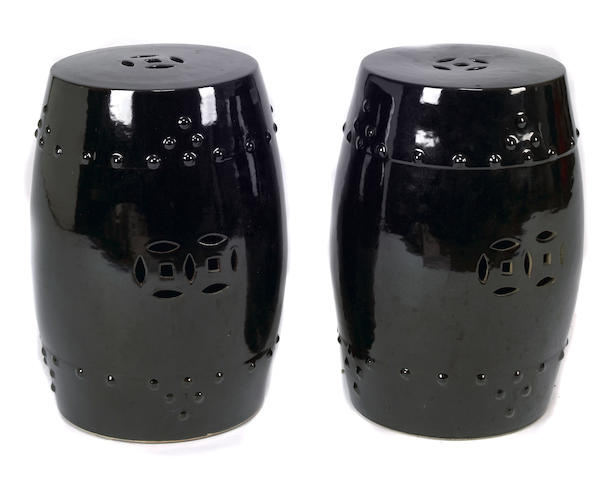 A pair of Chinese black glazed garden seats