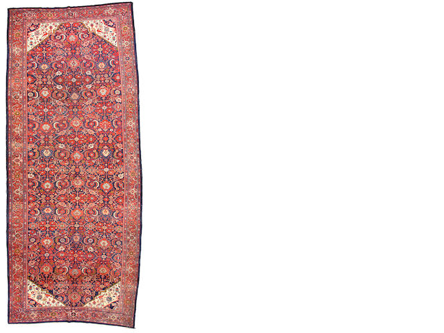 A Malayer long carpet Central Persia, size approximately 6ft. 10in. x 14ft. 10in.