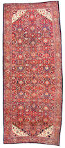 A Malayer long carpet size approximately 6ft. 10in. x 14ft. 10in.