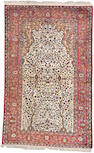 A silk Kashan rug Central Persia, size approximately 4ft. 1in x 6ft. 6in.