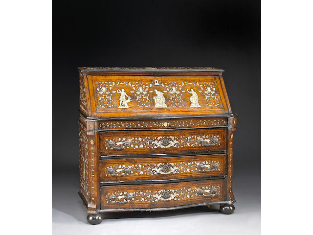 An Italian Baroque walnut and ivory inlaid secretary