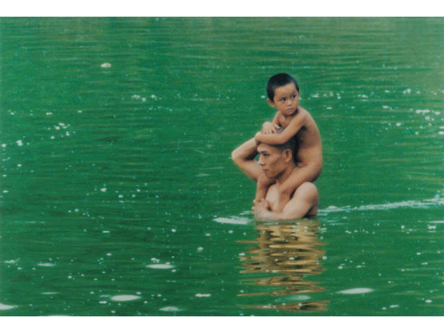 Zhang Huan (Chinese, born 1965) To raise the water level in a fishpond (Waterchild), 1997 27 x 40in (69 x 102cm)