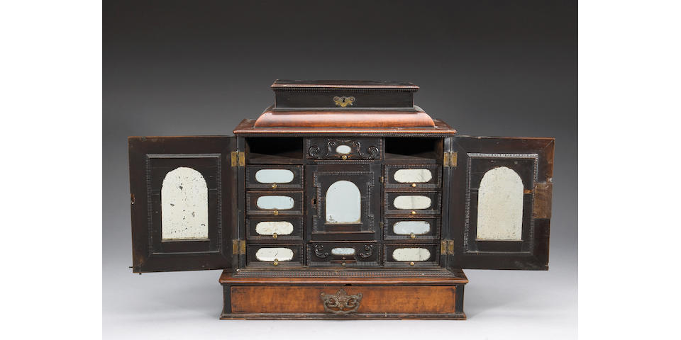 A Continental Baroque walnut table cabinet