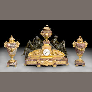A French breche violette marble gilt and patinated bronze clock garniture