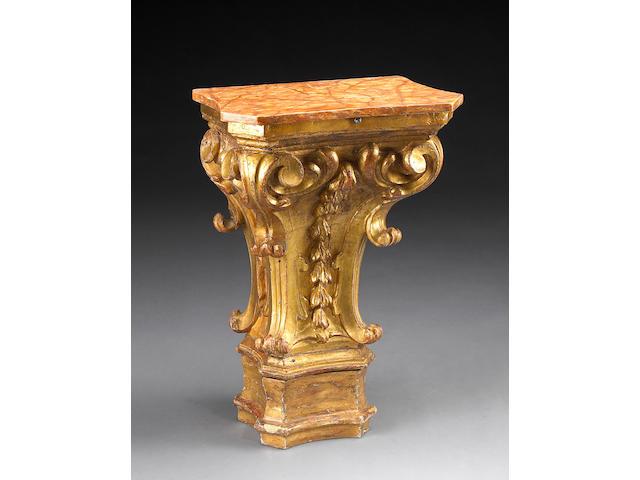 An Italian Baroque giltwood Corinthian capital console