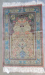A Turkish silk and metal thread rug size approximately 3ft. 1in. x 4ft. 9in.