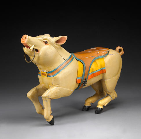 A carved and painted carousel pig