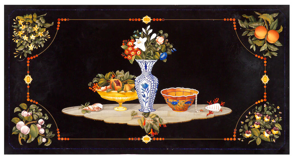 A fine Italian Baroque Revival giltwood and pietra dura center table  probably Florence  mid 19th century