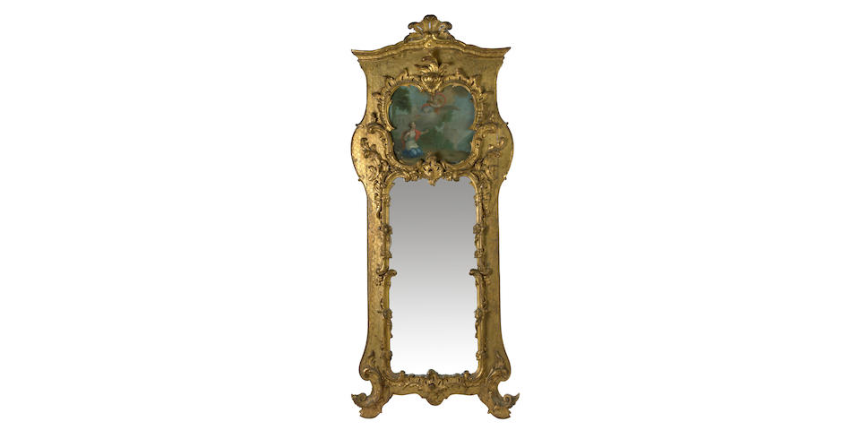 A Continental Rococo style giltwood trumeau mirror