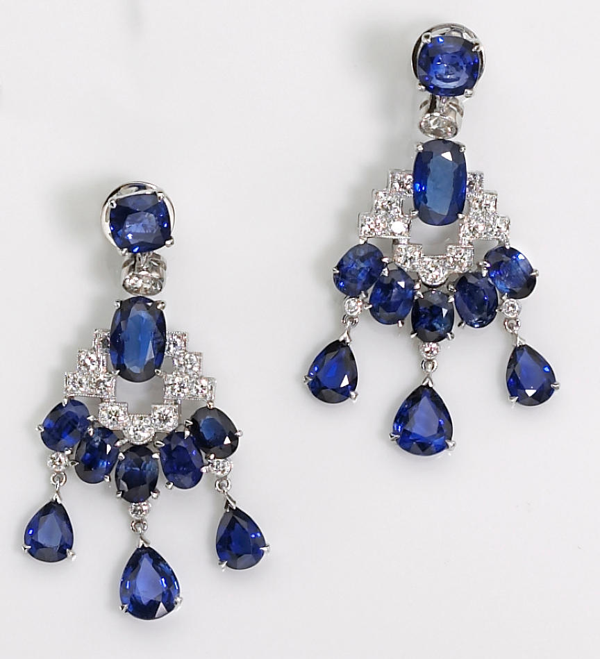 A pair of sapphire and diamond pendant earrings