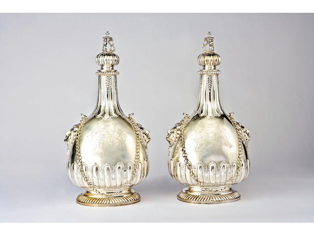 A monumental pair of Edwardian silver pilgrim's bottles