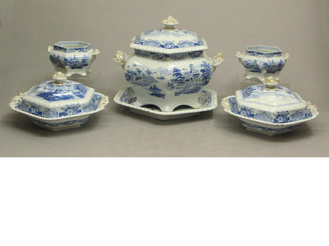 A Staffordshire  parcel gilt, blue and white transfer printed dinner service in the 'India Temple' pattern