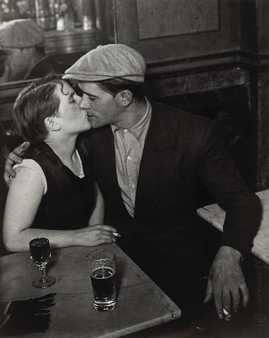 Brassaï (Gyula Halász) (Hungarian/French, 1899-1984); Couple d'amoureux dans un bistrot, rue Saint-Denis, Paris;