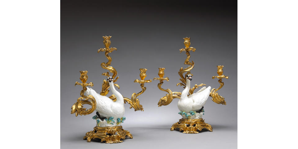 An important pair of Louis XV gilt bronze mounted Meissen porcelain three light candelabra