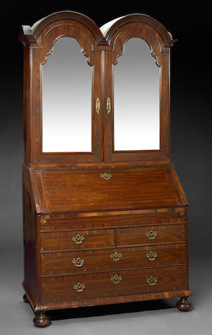 A Queen Anne walnut double dome secretary cabinet