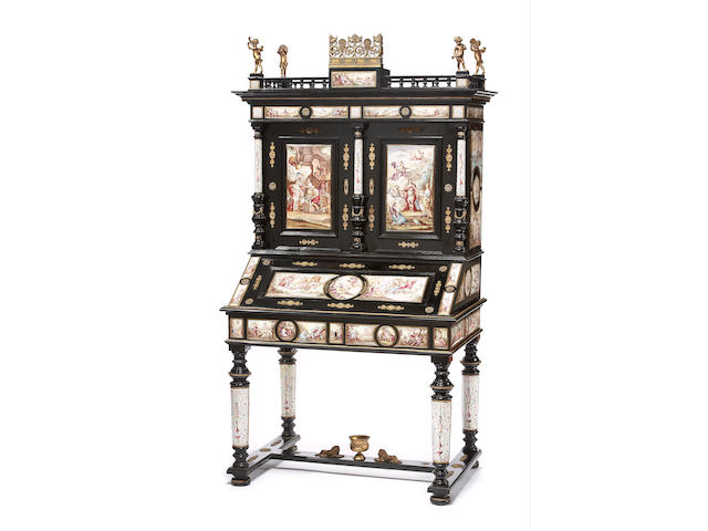 A fine Continental gilt-bronze and enamel-mounted ebonized cabinet