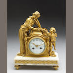 A Louis XVI style gilt bronze mounted mantle clock