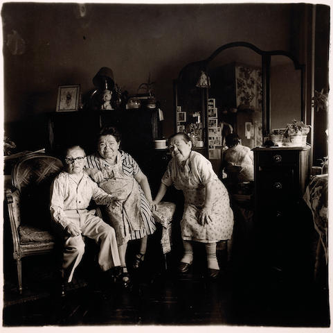 Diane Arbus (American, 1923-1971); Russian Midget Friends in a Living Room on 100the Street, New York;