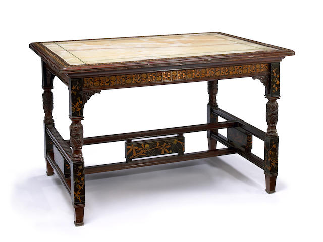 An important American Aesthetic inlaid and carved rosewood center table