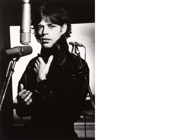 Helmut Newton (German, 1920-2004) Portrait of Mick Jagger during a recording session in Paris Gelatin silver print, signed, dated and titled in pencil on verso. 15 x 10in