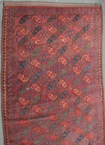 An Afghan carpet size approximately 6ft. 11in. x 10ft. 10in.