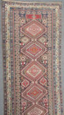 A Shirvan long rug size approximately 4ft. 10in. x 10ft. 7in.