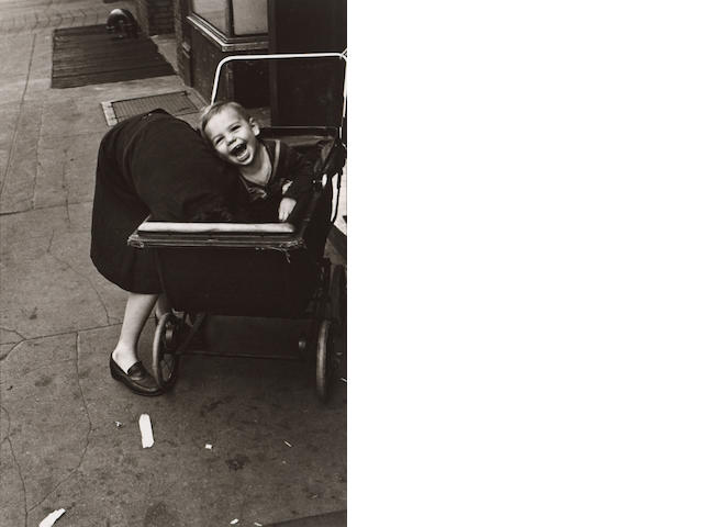 Helen Levitt (American, born 1918); New York City (Laughing Child in Baby Carriage);