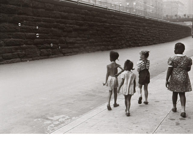 Helen Levitt (American, born 1918); New York City (Girls looking at bubbles);