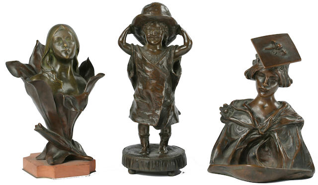 Three patinated bronze figures