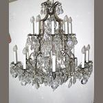 A Rococo style cut glass twelve light chandelier