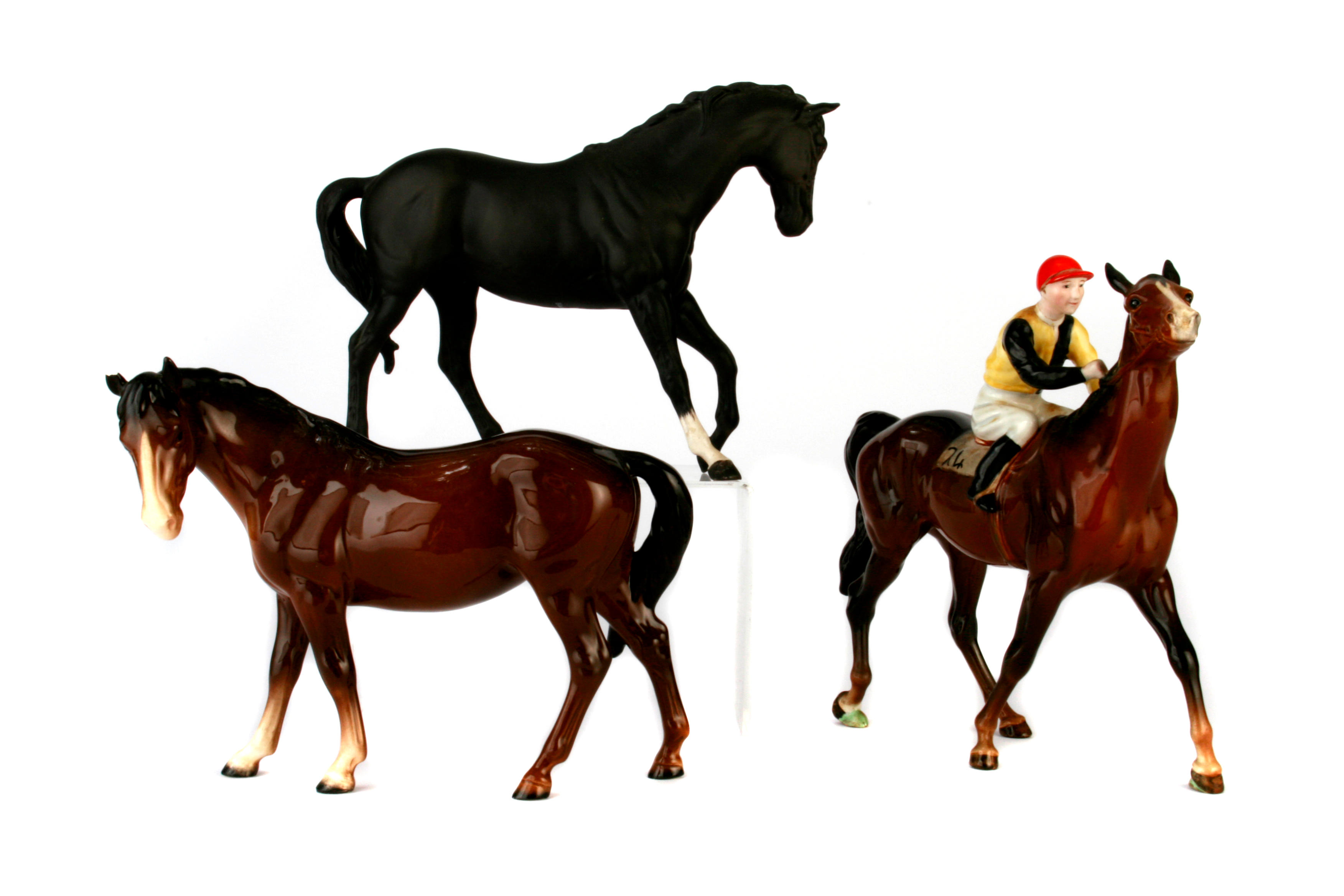 A group of three Beswick pottery models of horses