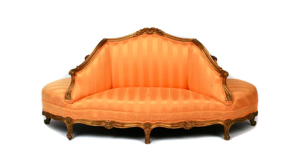 A Louis XV style giltwood conversational sofa
