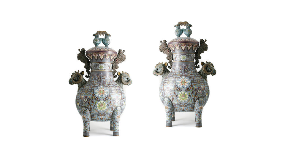 A pair of cloisonne enameled metal footed urns with ram's head handles