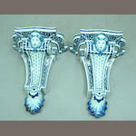 A pair of French Regence style faience wall brackets
