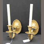 A pair of Louis XVI style gilt bronze single light bras de lumière