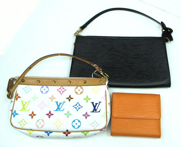 A group of three Louis Vuitton small purses and bags