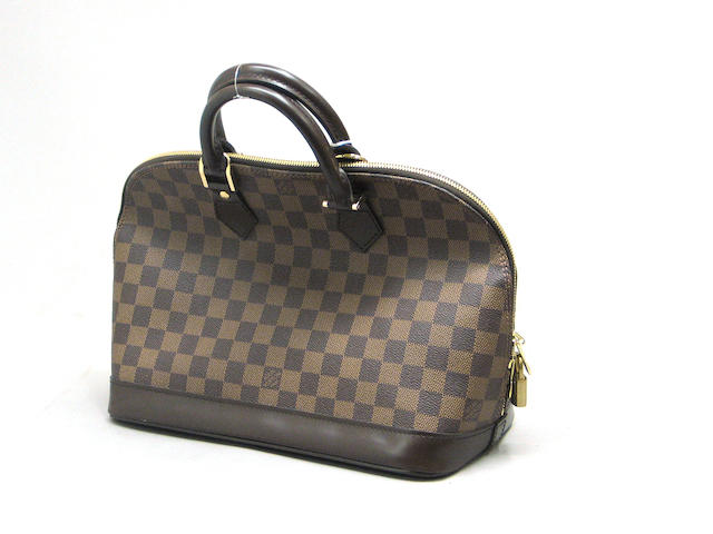 A brown Louis Vuitton Damier Canvas Alma bag