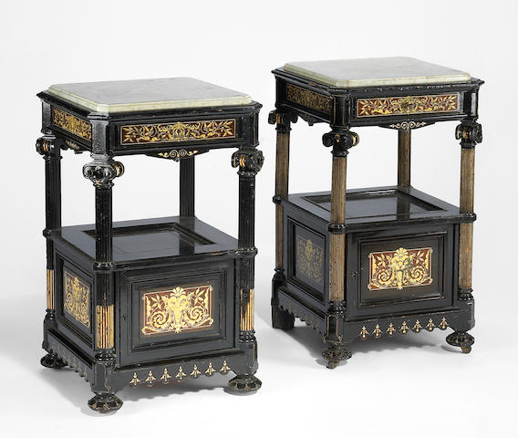 A pair of American Renaissance carved, inlaid and ebonized night stands