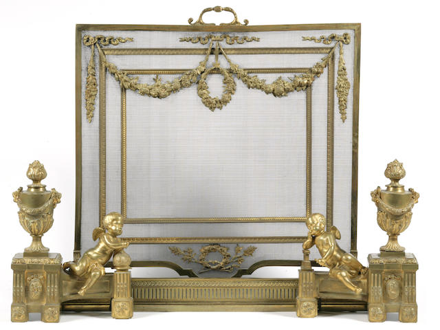 A pair of Louis XVI style gilt-bronze figural chenets and firescreen